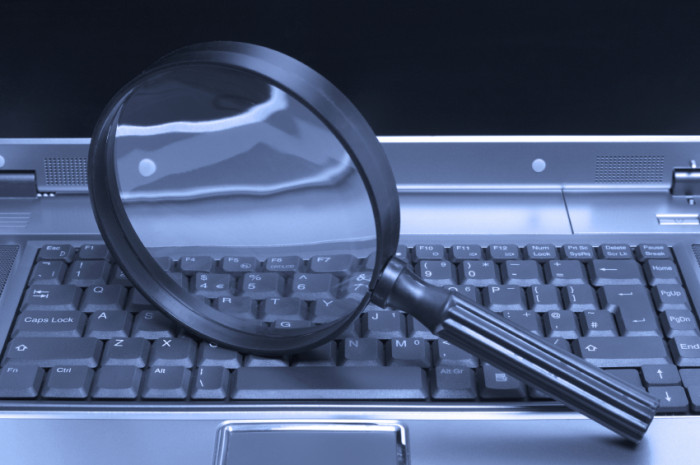 Laptop magnifying glass. ©iStockphoto/RTimages