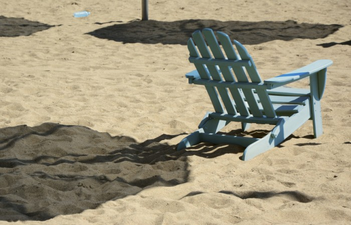 Adirondack chair on beach. ©iStockphoto/Pelikanz